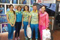 Дарья Блашко (вторая слева) и Мария Панфилова (крайняя справа) в спортивном магазине Киева.