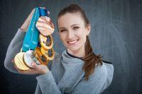 У Дарьи Домрачевой в коллекции медали сразу трех Олимпиад.