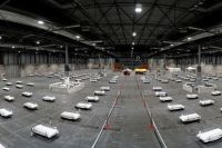 Кровати подготовлены для пациентов с коронавирусом в военном госпитале в конференц-центре IFEMA в Мадриде.