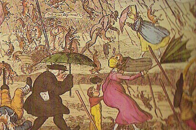 Английская карикатура XIX века, где идёт дождь из вил, собак и котов.